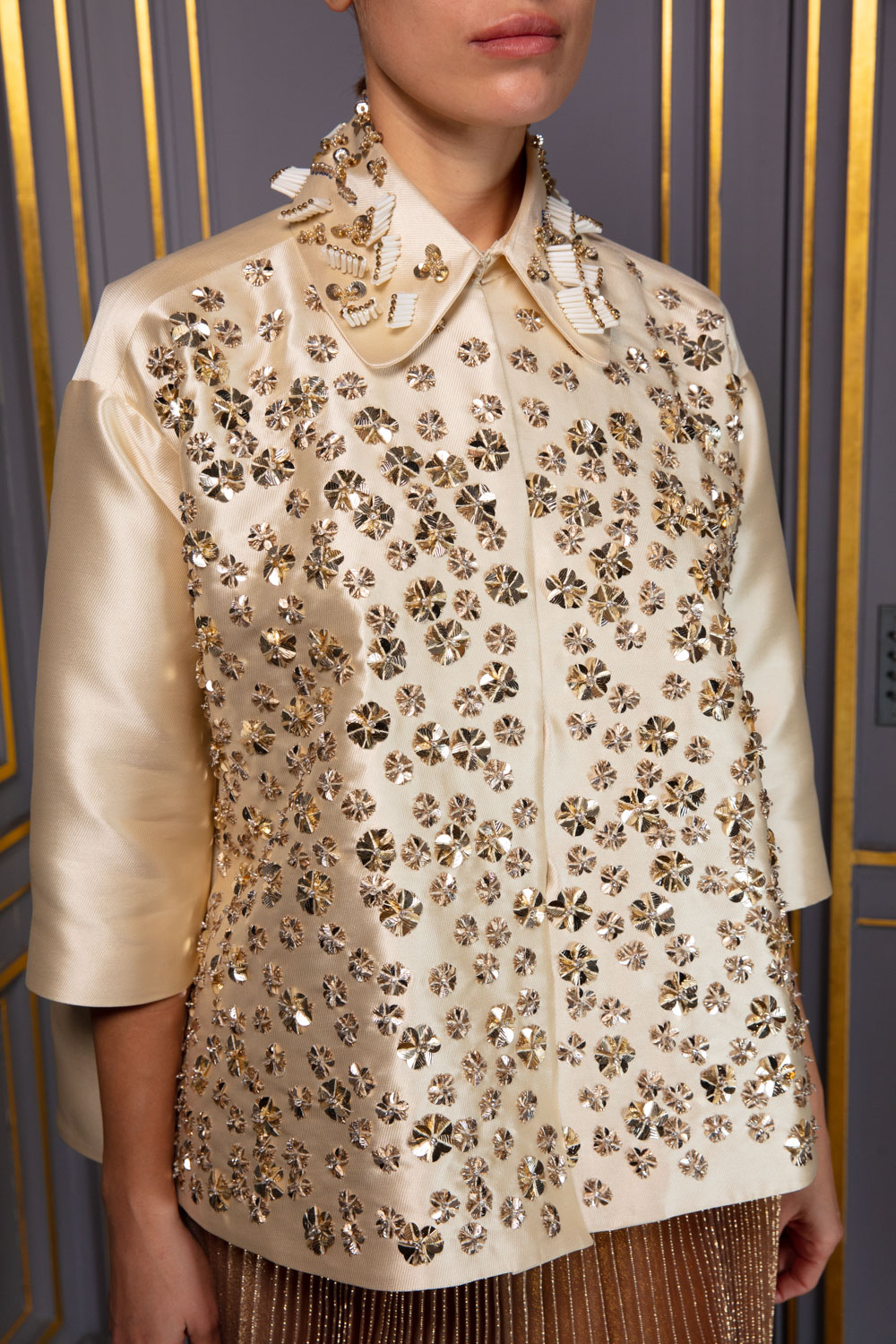 Pale gold swing jacket with golden embellishments